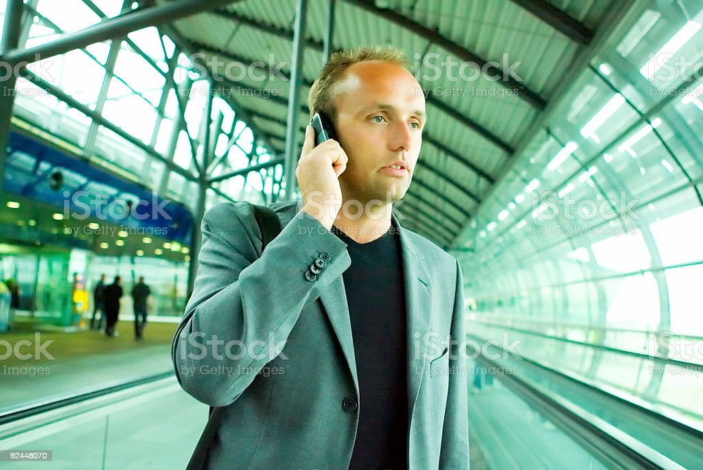 Business Man with mobile phone at airport. royalty-free stock photo