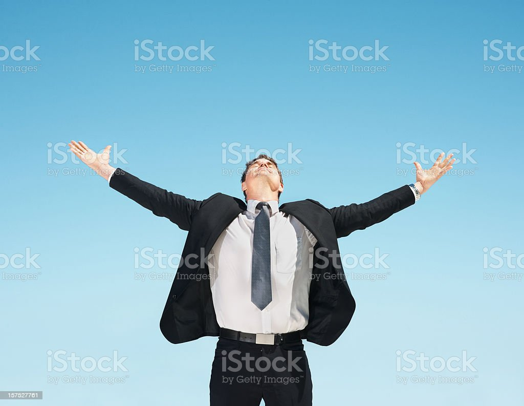Business man with outstretched arms royalty-free stock photo