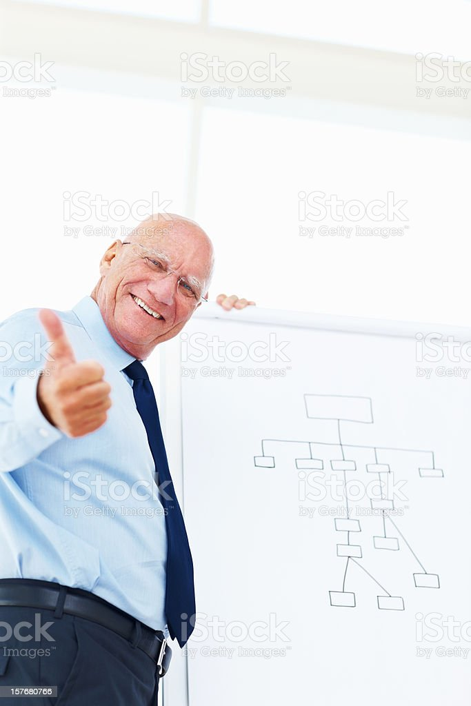Business man with presentation board and giving you thumbs up royalty-free stock photo