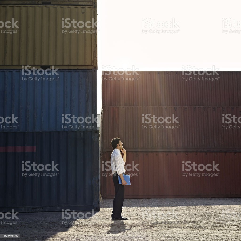 business man with shipping containers royalty-free stock photo