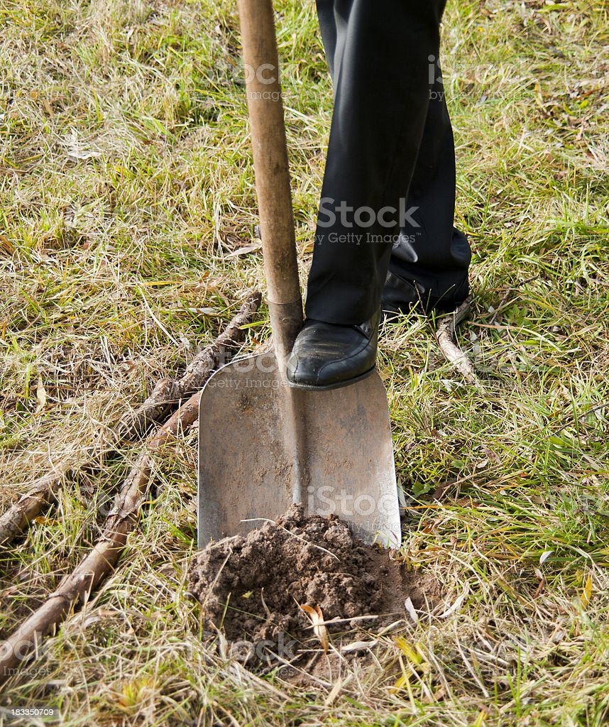 business man with shovel spade in garden stock photo