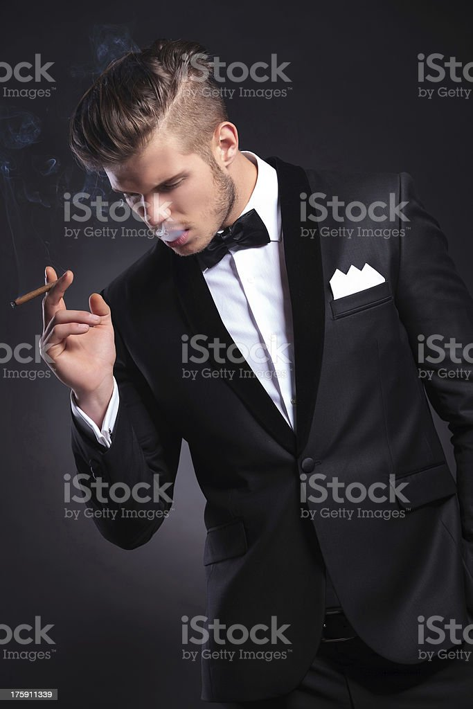 business man with smoke in his mouth royalty-free stock photo