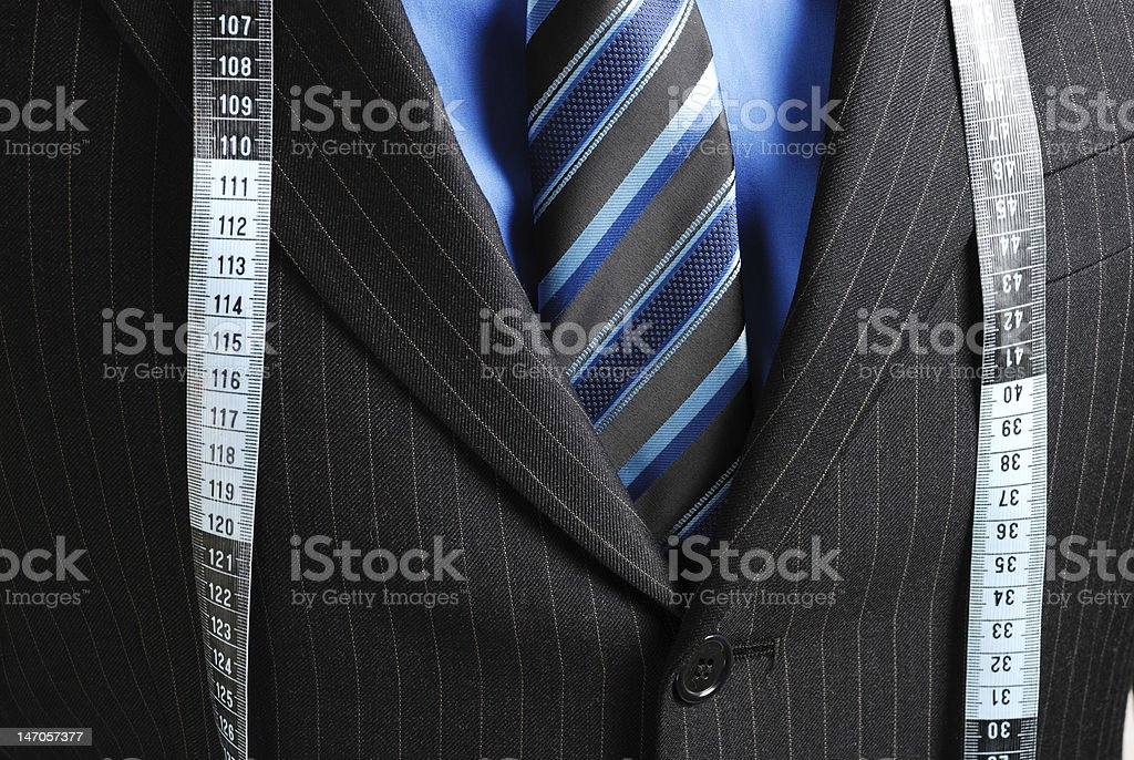 Business man with tape measure royalty-free stock photo