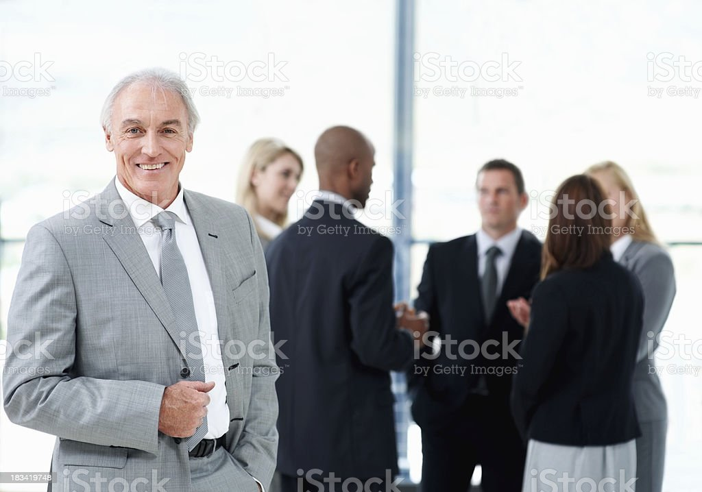 Business man with team discussing in background royalty-free stock photo