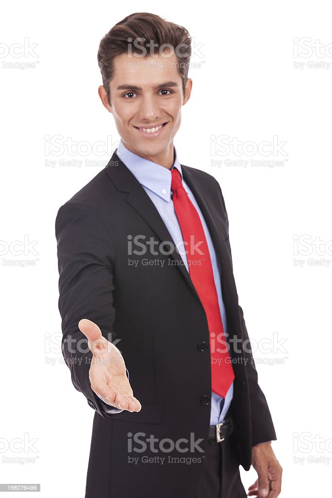 business man wlecoming you with a handshake royalty-free stock photo