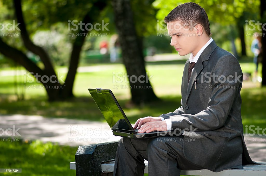business man work on notebook at park. Student stock photo