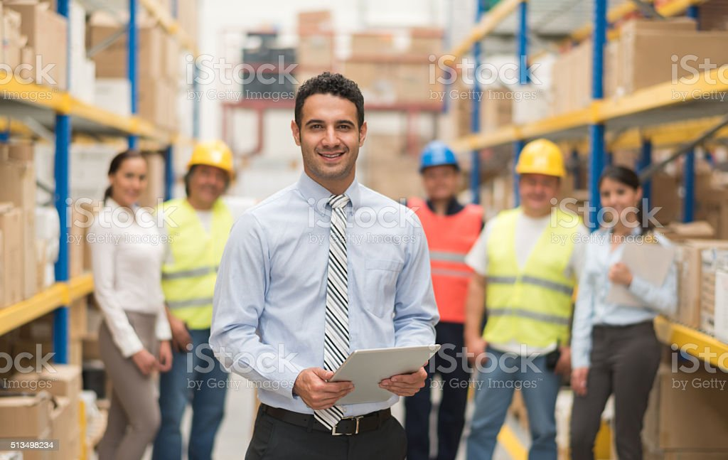 Business man working at a warehouse stock photo