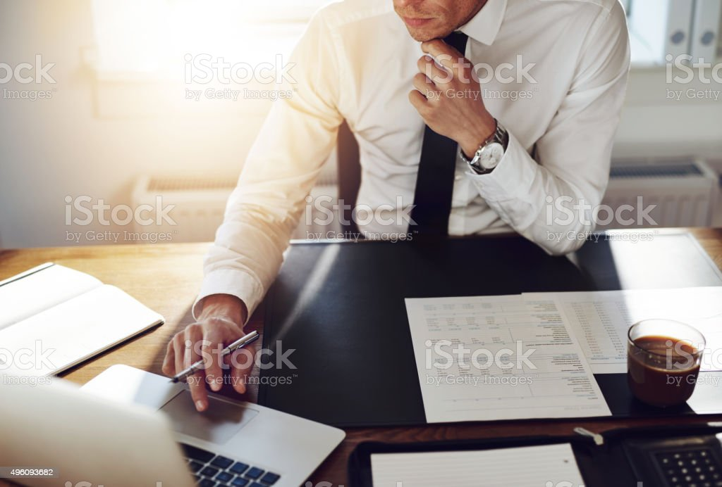 Business man working at office with laptop and documents on his desk,...