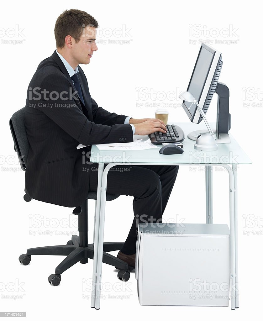 Business man working at office desk isolated on white royalty-free stock photo