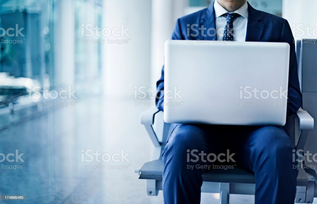 Business man working at the airport royalty-free stock photo