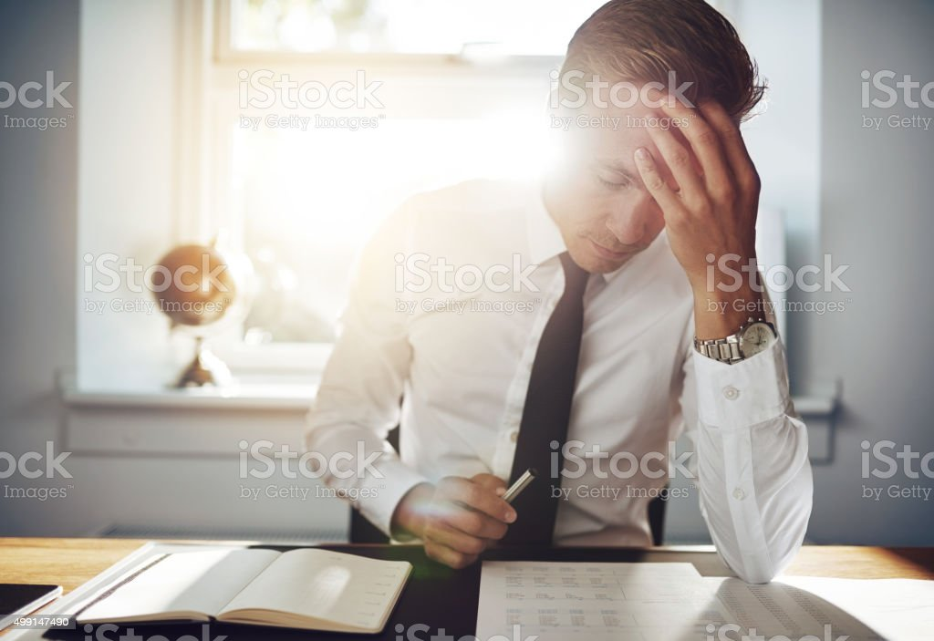 Business man working concentrated on documents stock photo