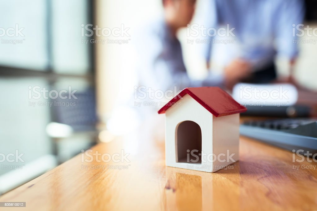 Business man working desk with financial paperwork data loan agreement with financial institution To buy real estate that is sold by public auction stock photo