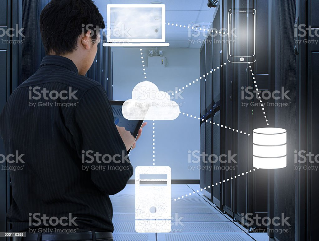 Business man working in data center with cloud technology stock photo