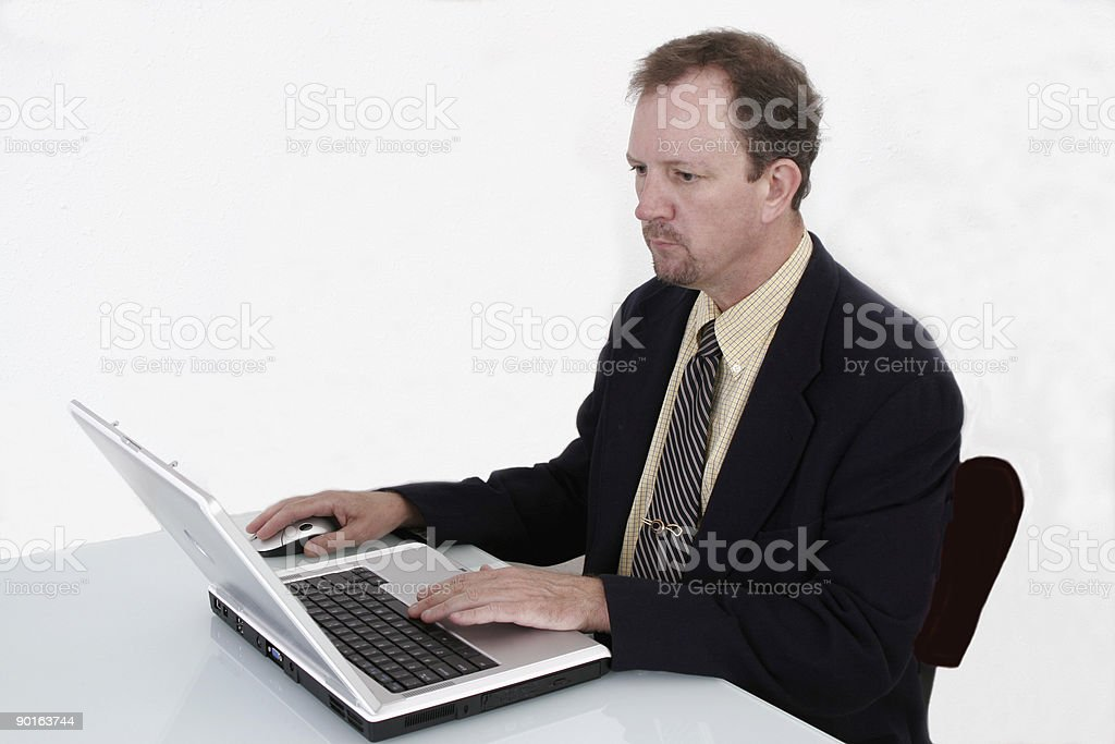 Business man working on a notebook computer royalty-free stock photo