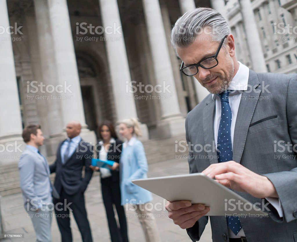 Business man working on a tablet computer stock photo