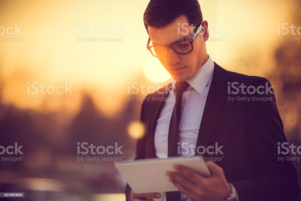 Business man working on digital tablet stock photo