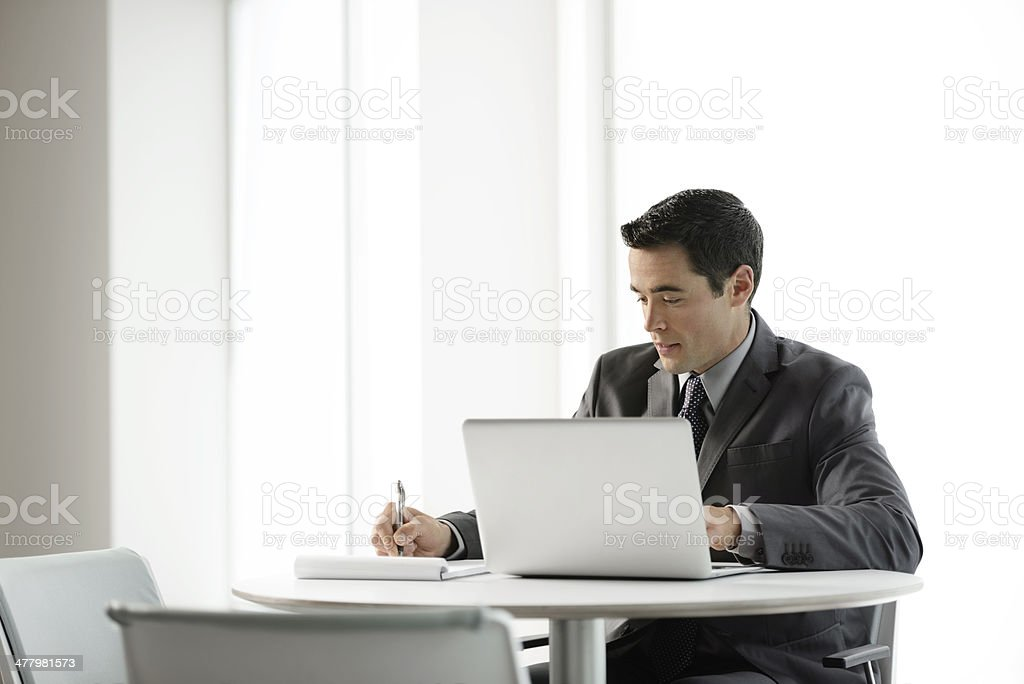 Business man working on laptop royalty-free stock photo