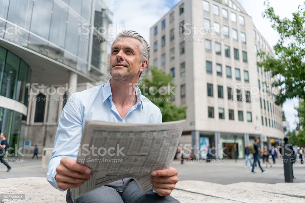 Business man working online outdoors stock photo