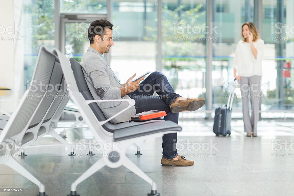 Business man working while waiting for a plane. stock photo