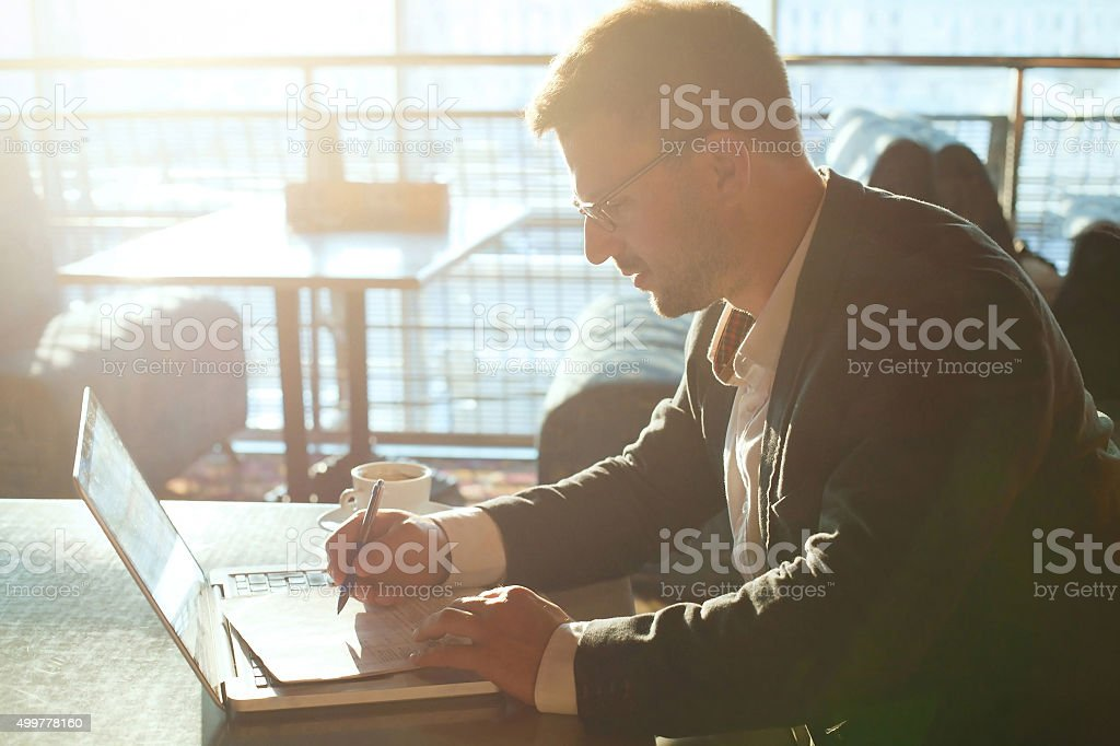 business man working with documents and laptop stock photo