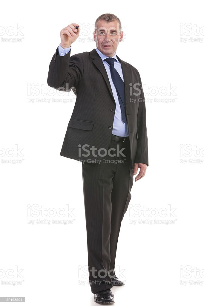 business man writes something with a marker stock photo