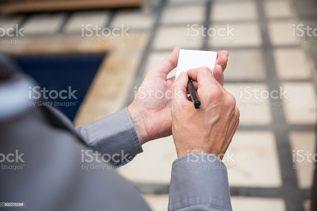 Business man writing  a note stock photo