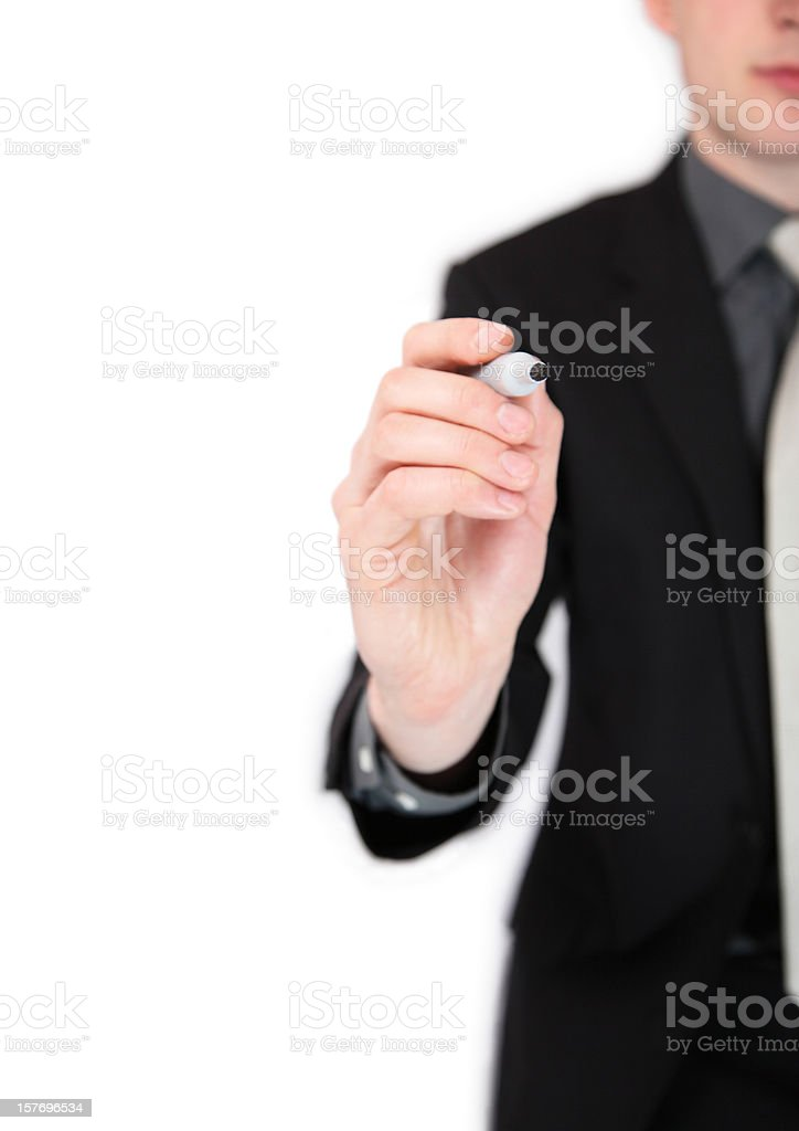 Business man writing at a whiteboard - Isolated royalty-free stock photo