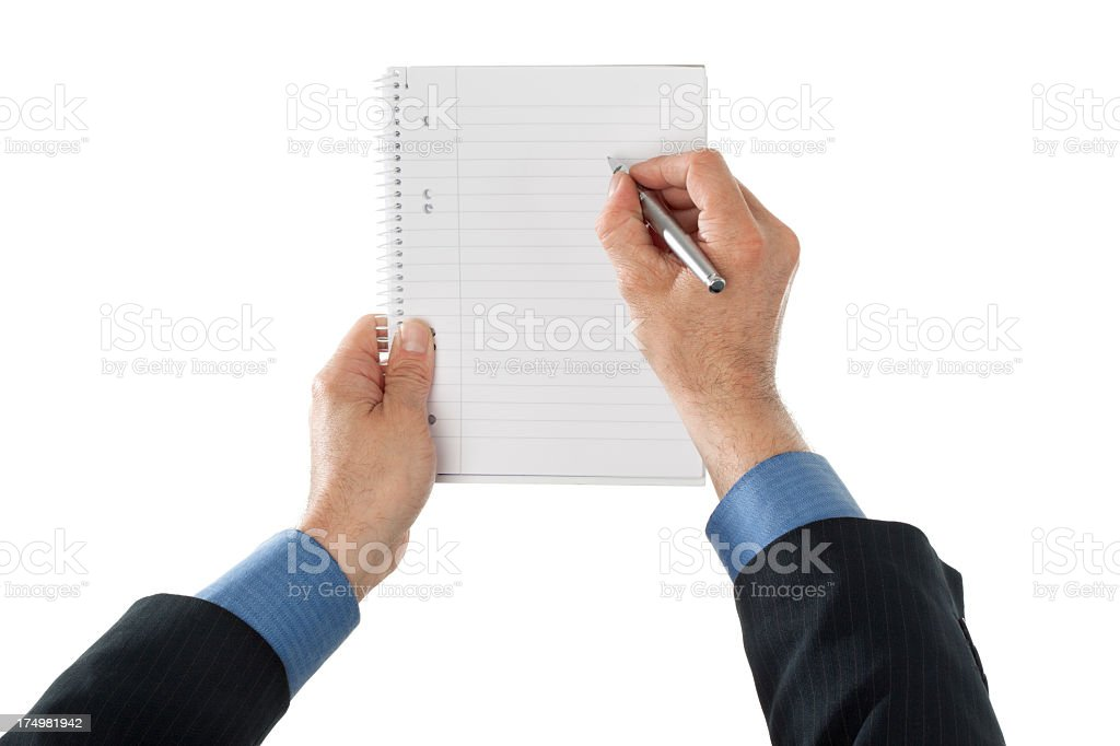 Business man writing in ring notebook royalty-free stock photo