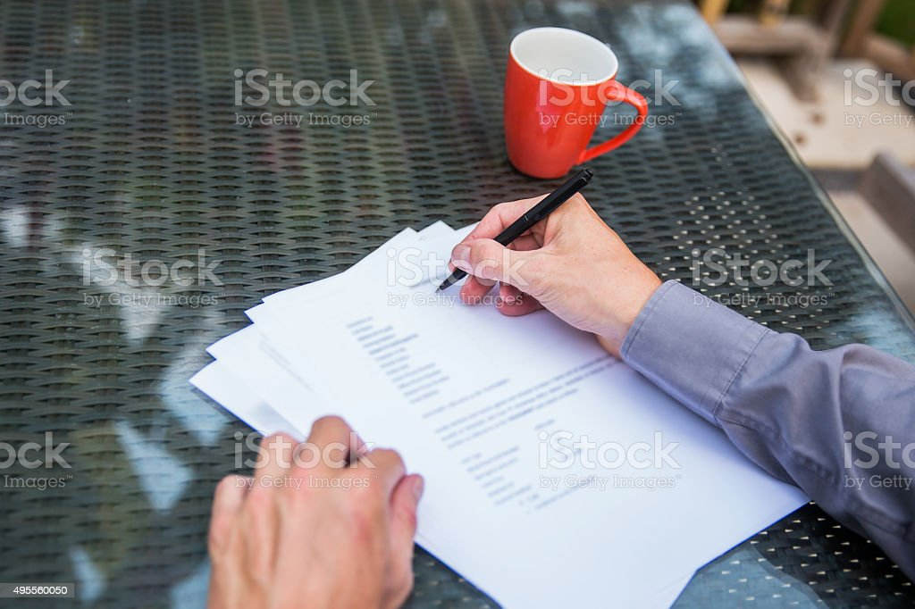 Business man writing on a contract form stock photo