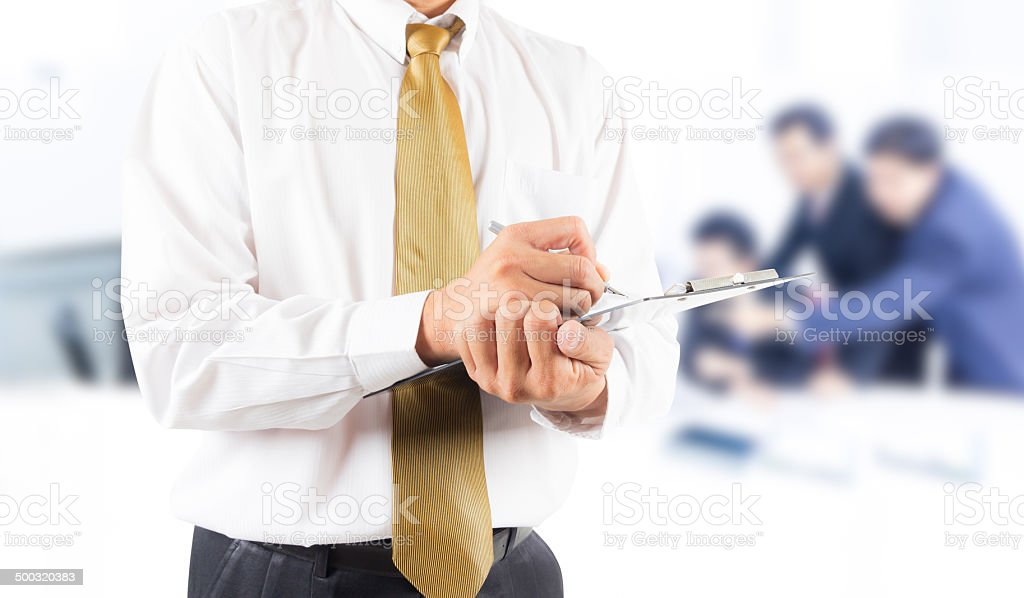 business man writing on clipbroad stock photo