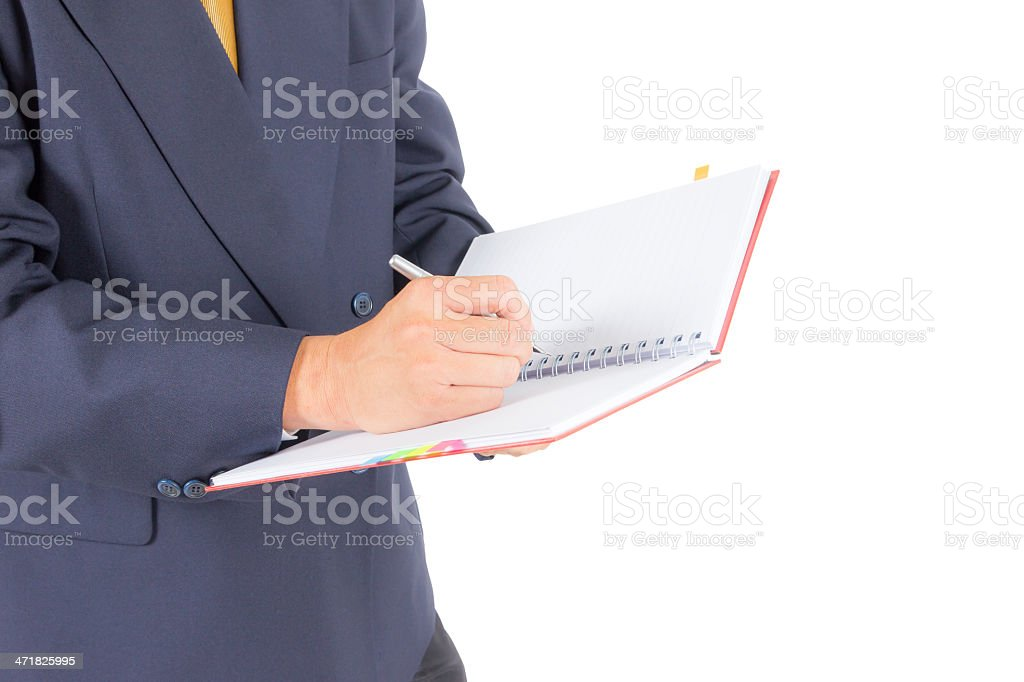 business man writing on notebook isolated with clipping path stock photo
