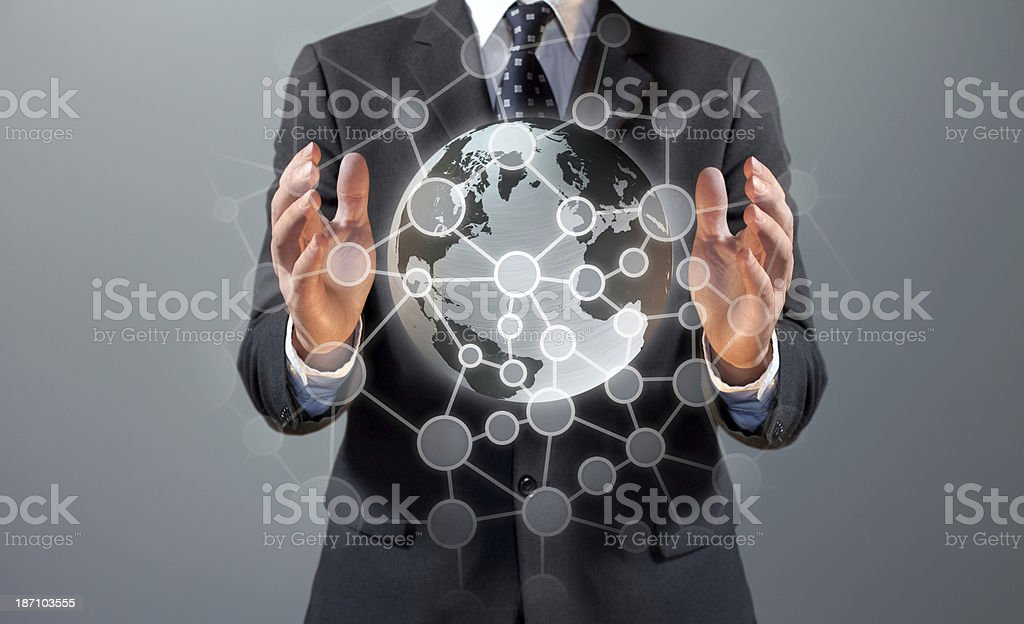 Business manager holding an Earth globe with social network connections stock photo