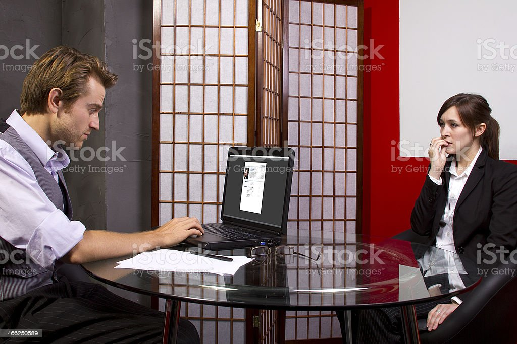 Business Manager Reviewing Nervous Employees Job Performance royalty-free stock photo