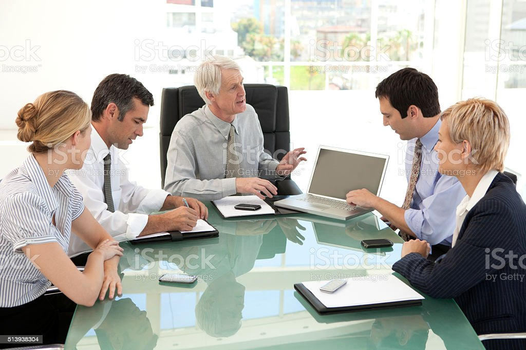 Business Managers discussing strategy stock photo