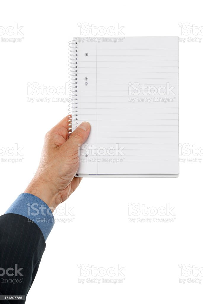 Business mans hand holding a paper notebook royalty-free stock photo