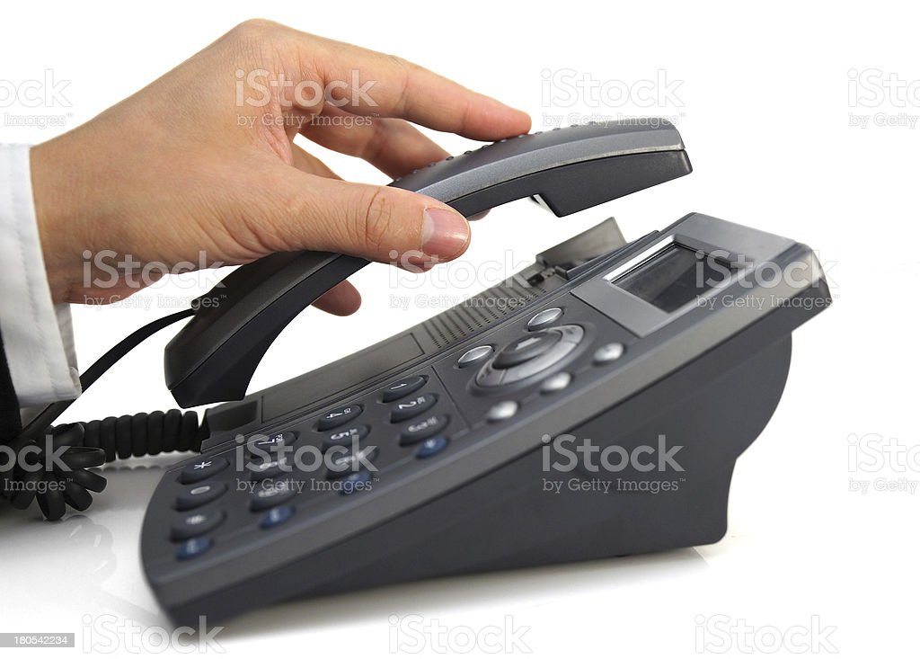business man's hand is picking up headset royalty-free stock photo