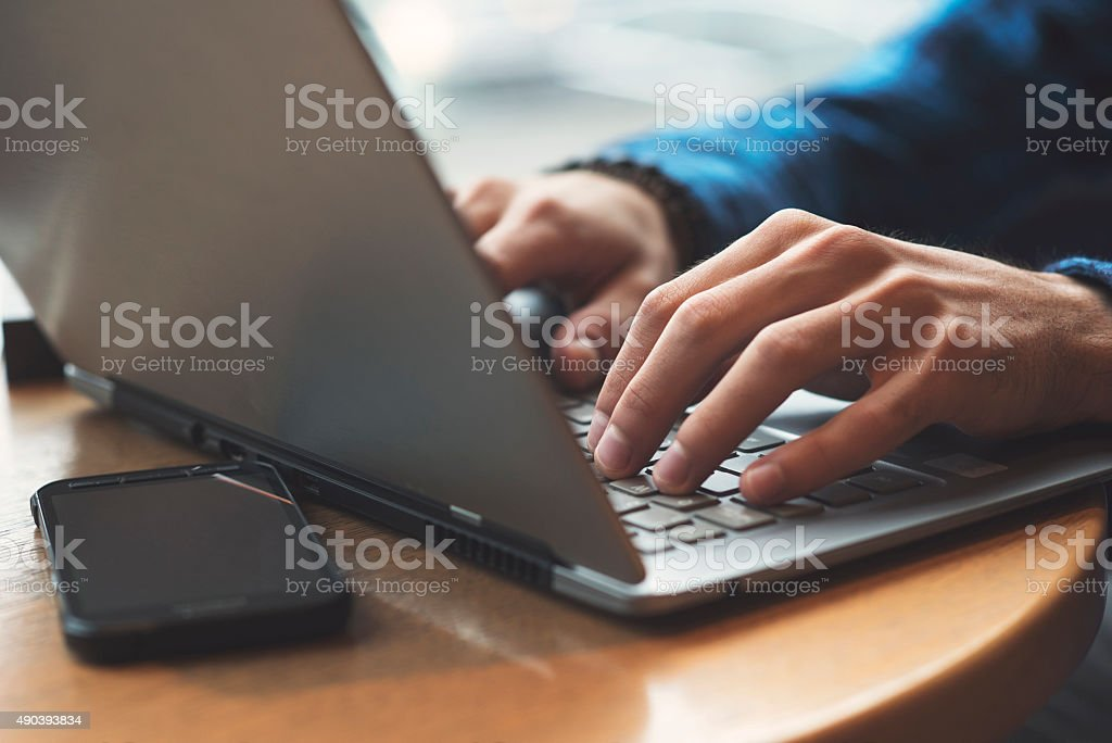 Business mans hands typing on laptop stock photo