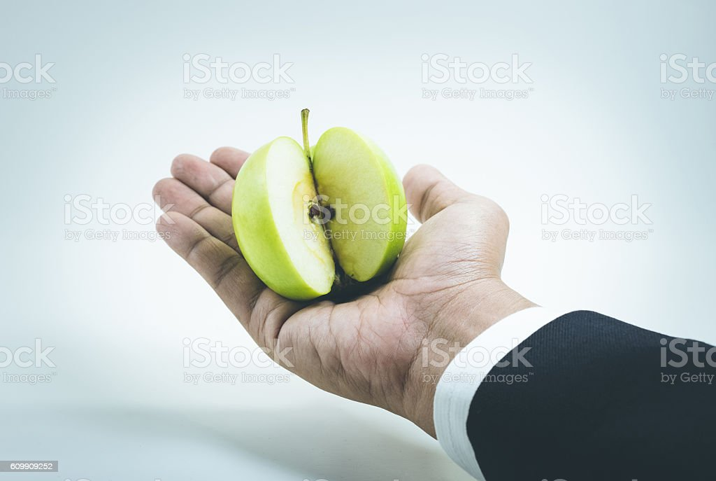 Business market share concept.A piece apple on hand. stock photo