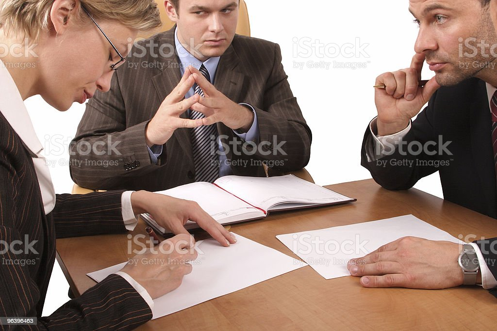 Business meeting - 3 people, negotiations royalty-free stock photo