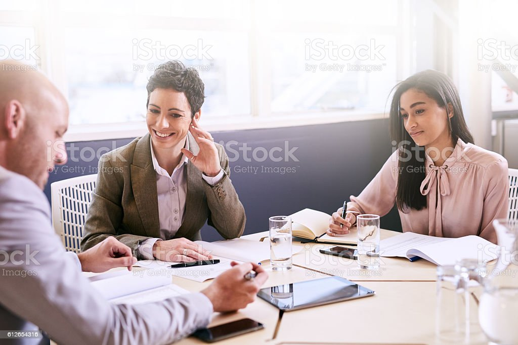 Business meeting between three professional partners early in the morning stock photo