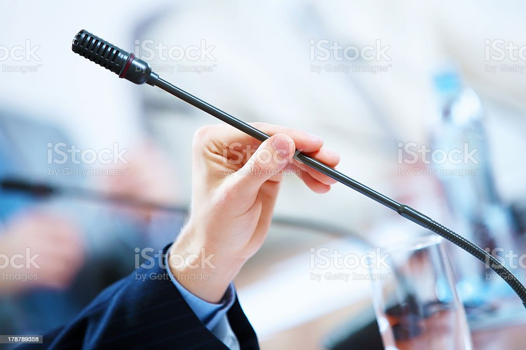 A business meeting in a conference hall with microphones royalty-free stock photo