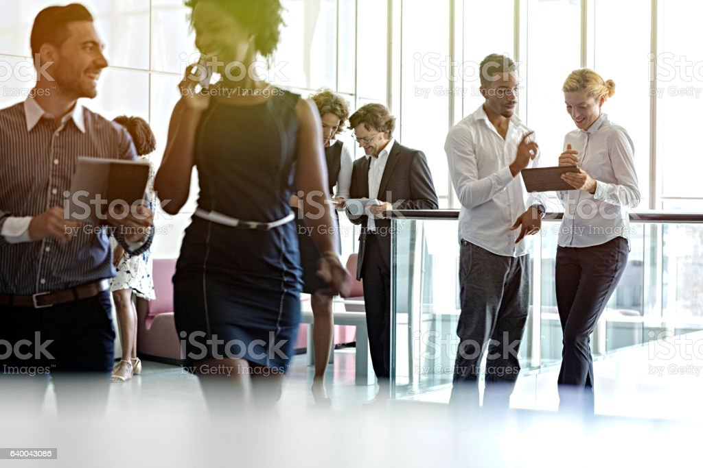 Business meeting  in office hallway stock photo