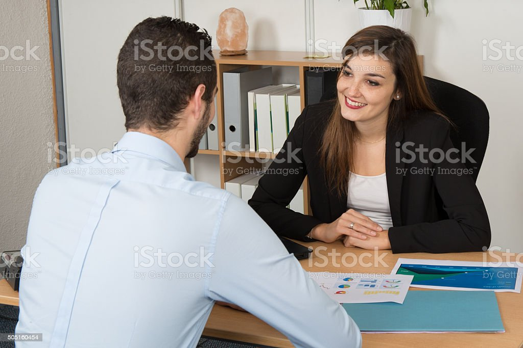 Business meeting , man and woman, at bank or insurance. stock photo