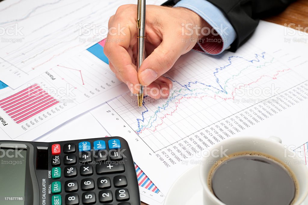 Business Meeting, man's hands pointing on graphs royalty-free stock photo