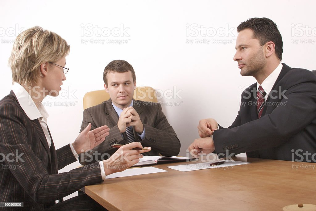 Business meeting of 3 persons stock photo