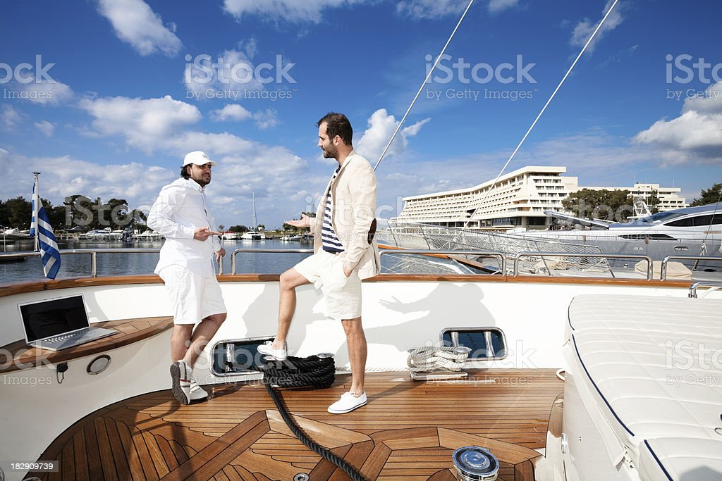 Business meeting on board of the yacht stock photo