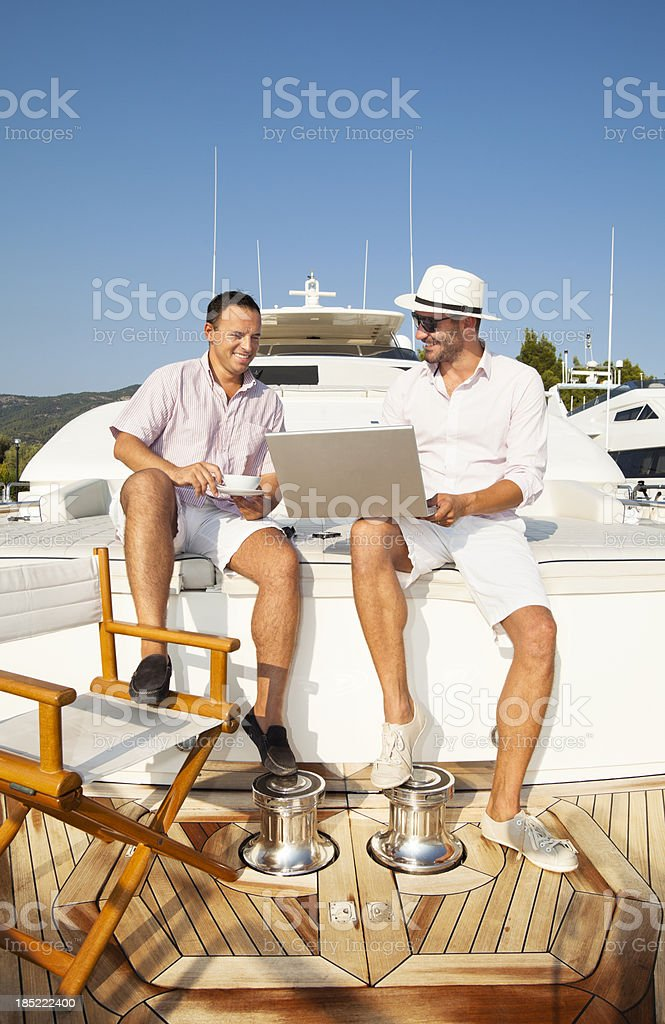 Business meeting on board of the yacht. stock photo