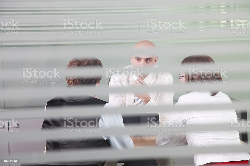 Business meeting through glass window royalty-free stock photo