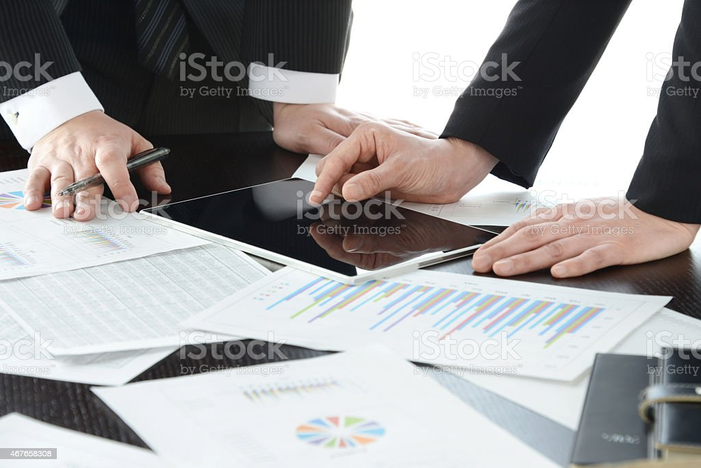 Business meeting with digital tablet and papers stock photo