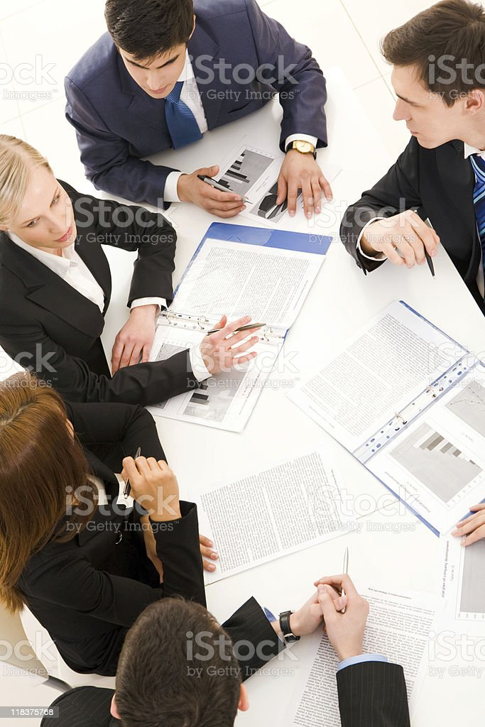Business meeting with discussion amongst team royalty-free stock photo